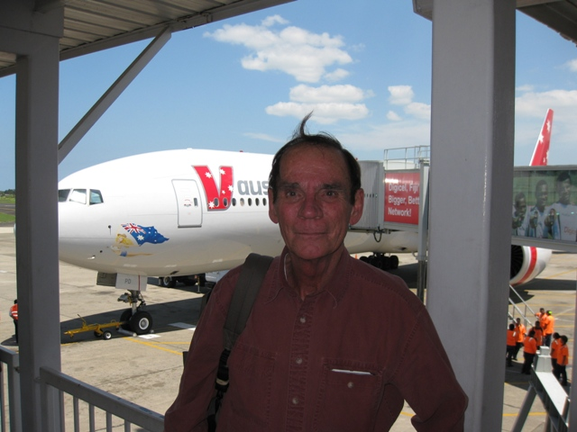 Dennis in front of our plane in Fiji